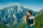 Beautiful Young Woman Enjoying Valley View Nature Over Mountain Landscape. Travel. Good Life.