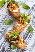 Zucchini, carrot and goat's cheese bruschetta