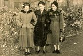 GERMANY, CIRCA FORTIES - Vintage photo of three women in winter coats