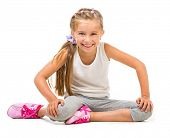 happy  little girl goes in for sports. studio shot isolated on white background