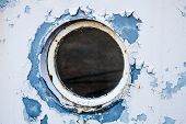 Round Porthole In White And Blue Ship Wall