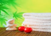 Spa Massage Border Background With Towel Stacked,red Candles And Stone
