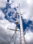 stock photo of mast  - Sails and mast with radar of a modern sail boat boating sailing background - JPG