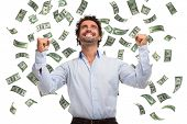 foto of rain  - Happy man enjoying a rain of money - JPG