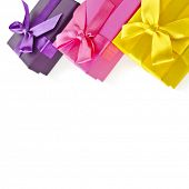 colorful gift boxes wrapped ribbon bows surface close up isolated on white background
