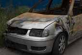 Wrecked And Burning Car Close Up