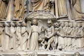 PARIS, FRANCE - NOV 05,2012: architectural detail of Notre Dame cathedral.Detail of central portal, depicting the Last Judgment (c.1230).