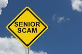 stock photo of hustle  - Senior Scam Warning Sign An road warning sign with words Senior Scam with blue sky background - JPG