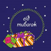 Beautiful greeting card design with colourful gift boxes on blue background for the occasion of Musl