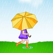Cute little girl holding an umbrella in under heavy rains on nature background.