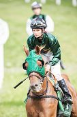 Woman Jockey Into A Curve At The Nationaldags Galoppen In Gardet