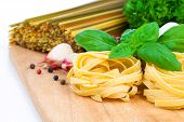 Italian Pasta Fettuccine Nest With Garlic And Fresh Basil Leaves,