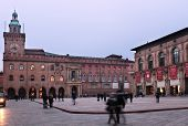 BOLOGNA, ITALY - JANUARY 12, 2013: People on the Piazza Maggiore against the Palazzo d'Accursio, or