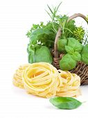 Italian Pasta Fettuccine Nest With Fresh Basil Leaves