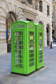 LONDON, UK - JULY 03, 2014: British telephone box in green. Bank of England.