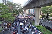 BANGKOK - JAN 2014: Unidentified Thai protesters walking along the road