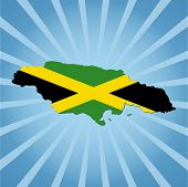 Jamaica map flag on blue sunburst vector illustration