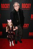 NEW YORK-MAR 13: Writer Thomas Meehan (R) and granddaughter Emma attend the 'Rocky' Broadway opening