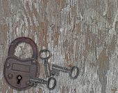 Vintage Padlock On A Old Wooden Panel