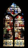 PARIS,FRANCE - NOV 11,2012:Saint Vincent de Paul raising a newborn and christening, stained glass.St