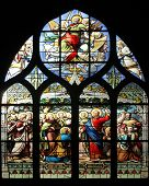 PARIS,FRANCE - NOV 11,2012:Jesus gives Peter the keys to the Kingdom, stained glass.The Church of St