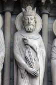 PARIS, FRANCE - NOV 05, 2012: King David, architectural detail of Notre Dame cathedral. Portal of St
