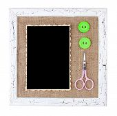Wooden frame with blank old photo, decorated with colorful buttons and scissors, isolated on white