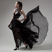 stock photo of flutter  - Fashion woman in fluttering black dress - JPG
