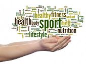 Concept or conceptual abstract sport and health word cloud in human man hand isolated on white backg