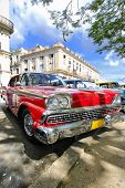 HAVANA, CUBA - NOVEMBER 4, 2009: View of red classic vintage american car parked, commonly used as p
