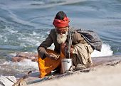 Holy Man Guru On Rock Along Betwa River.