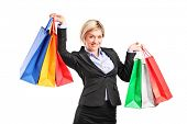 Businesswoman holding shopping bags isolated on white background