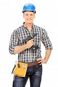 Male carpenter holding an electric drill isolated on white background