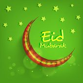 Red and golden crescent moon on stars decorated green background for Muslim community festival Eid M