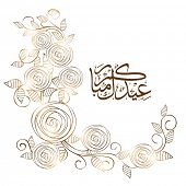 Arabic islamic calligraphy of text Eid Mubarak with shiny floral decorated greeting card design for