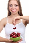 Beautiful girl with cherry, isolated on white