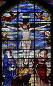 PARIS, FRANCE - NOV 09, 2012: Crucifixion, Jesus on the cross, stained glass. Church of Saint-Jean-d