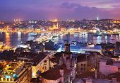 ISTANBUL, TURKEY - MARCH 12, 2014: Night view to Golden Horn bay and Galata bridge. Built in 1992, t