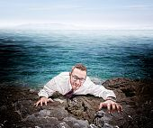 castaway businessman climb the cliff
