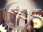 man run in a huge hamster wheel to produce power