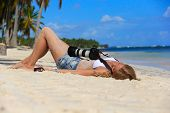 Girl On The Caribbean Beach With A Camera