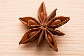 Organic star anise on a wooden table