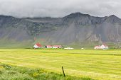 Farms and Mountains in Iceland