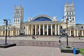 KHARKOV, UKRAINE - JUNE 5, 2014: People in front of the building of the main railway station. The bu
