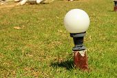 Lantern In The Park And Green Grass