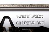 image of typewriter  - Fresh start chapter one printed on an old typewriter  - JPG