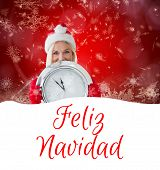 happy festive blonde with clock against feliz navidad