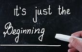 It's Just The Beginning handwritten with chalk