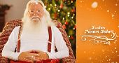 Smiling santa without his jacket relaxing against orange vignette