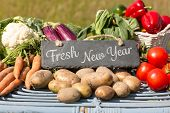 Fresh New Year against vegetables at farmers market